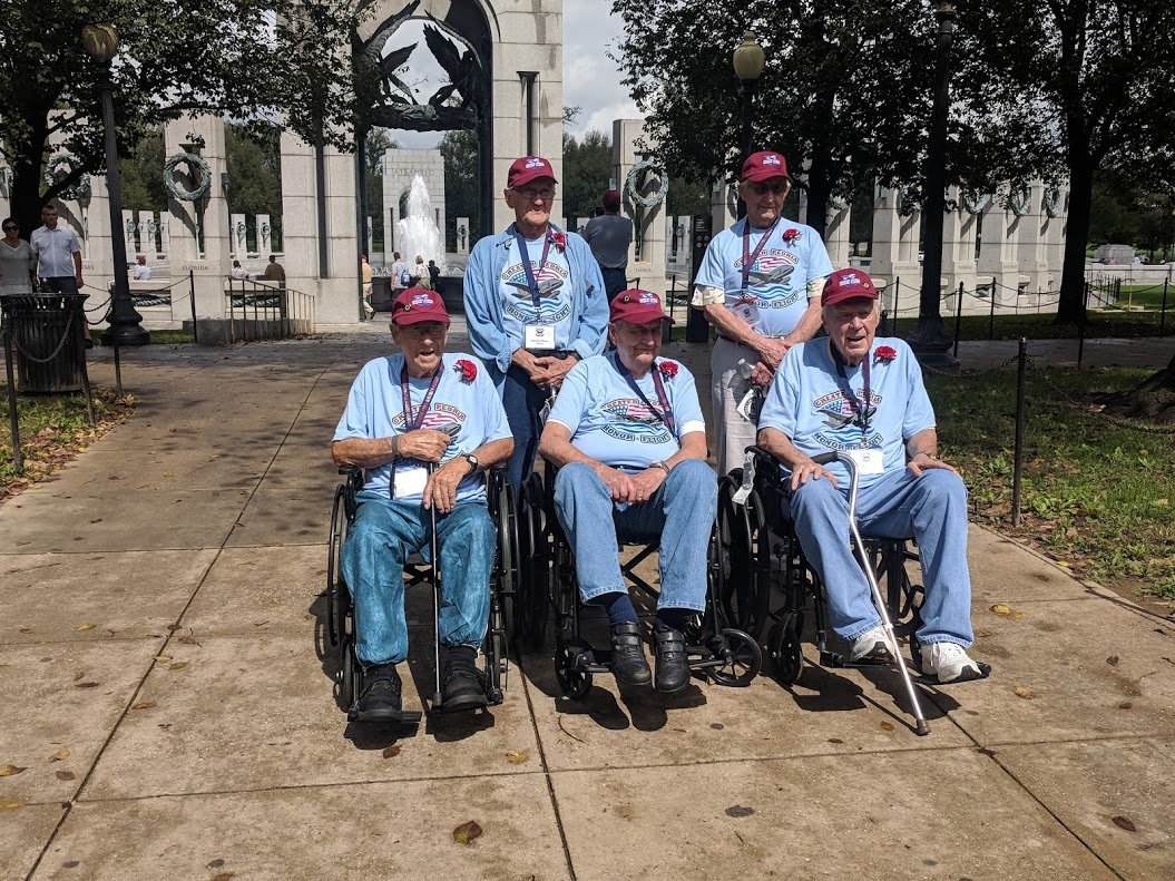 The five World War II Veterans on the flight. Ray Warren is bottom left.