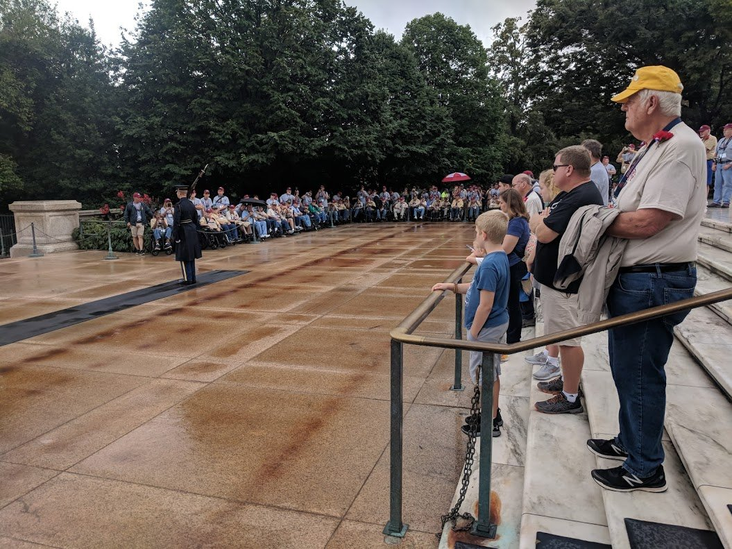 The Honor Flight vets watch the soldier guard the tomb
